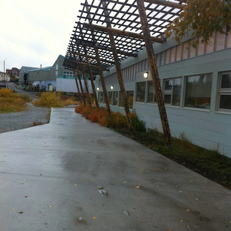 The outside of K'Alemi Dene School. I really like the wood elements attached to the structure.