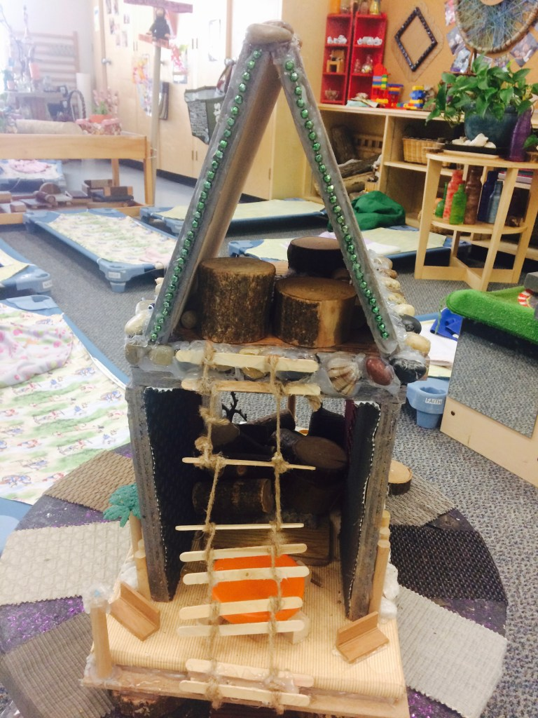 Another co-created building! I absolutely love the attention to detail like the popsicle stick ladder! So much creative and imaginative play for the toddlers to engage in!