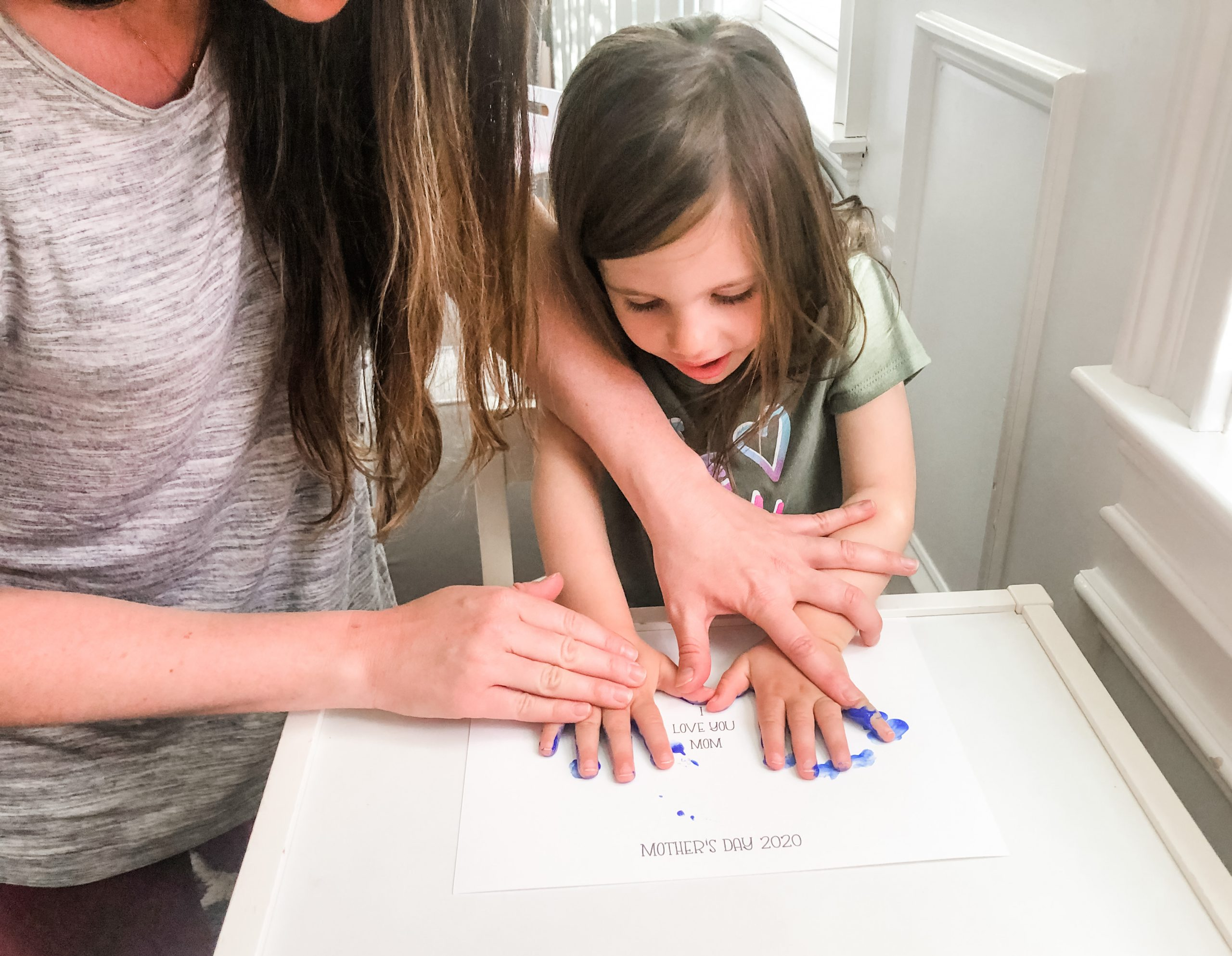 Here is a simple Mother's Day craft you can do with your little one as a sentimental gift for any mom using your child's handprint with fingerpaint.