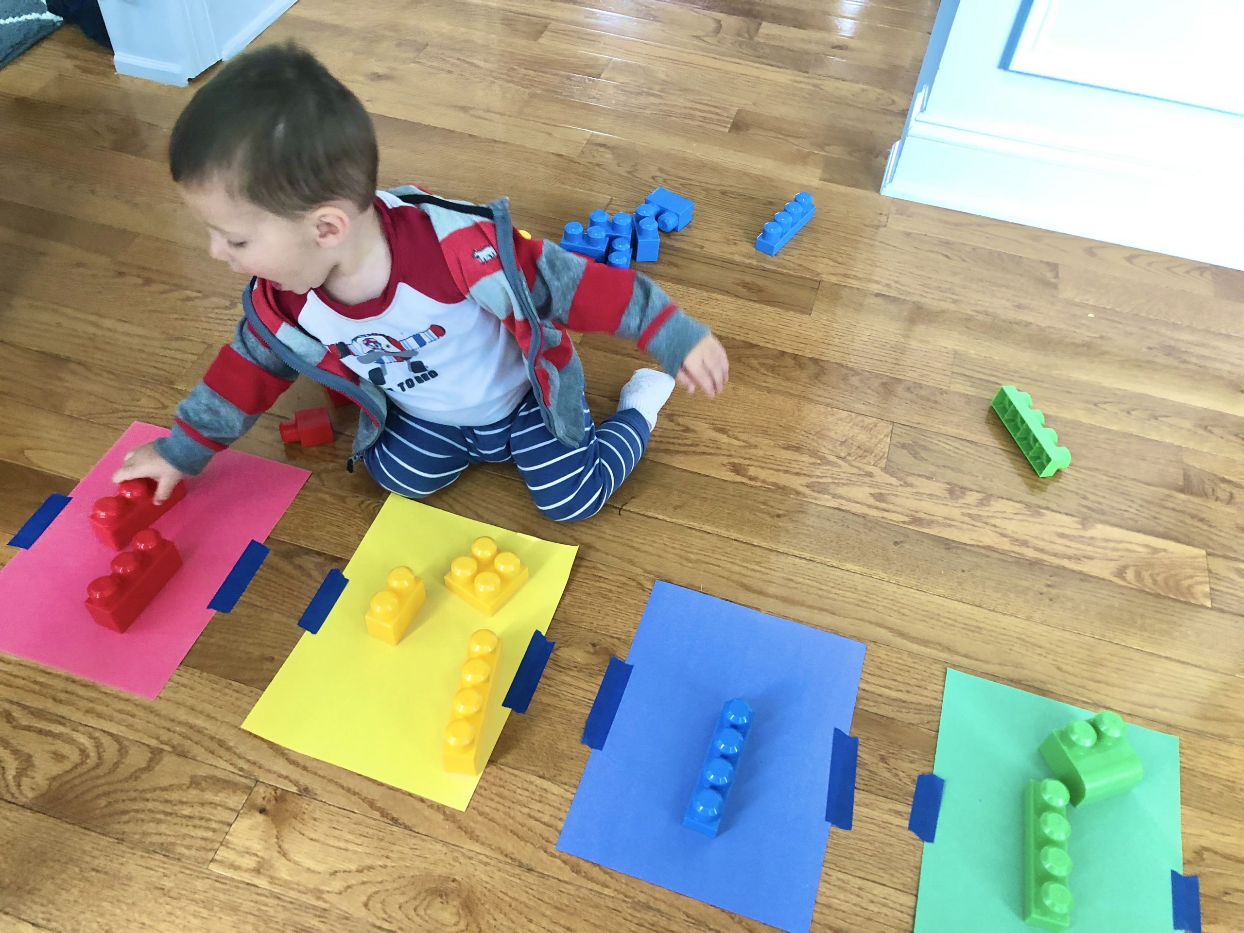 Teach your toddler colors using this activity to match and sort toys or blocks. They will gain color recognition as they learn the colors and match them.