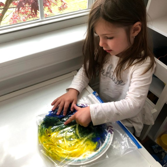 This no-mess finger painting activity is a great sensory experience for babies and toddlers to keep them busy. Improve fine motor skills with no clean up.
