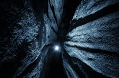 25132166 - cave with light at the end and stone walls