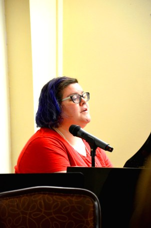 Rachel singing and playing the piano