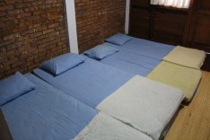 beds on the floor of the villa