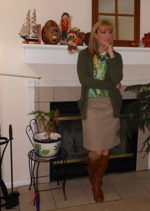 Olive green cardigan: Target. Green and Yellow sleeveless silky blouse: Target. Green earrings: Versona. Khaki skirt: (thrifted.) Silver watch: Fossil. Tan riding boots: Old Navy.
