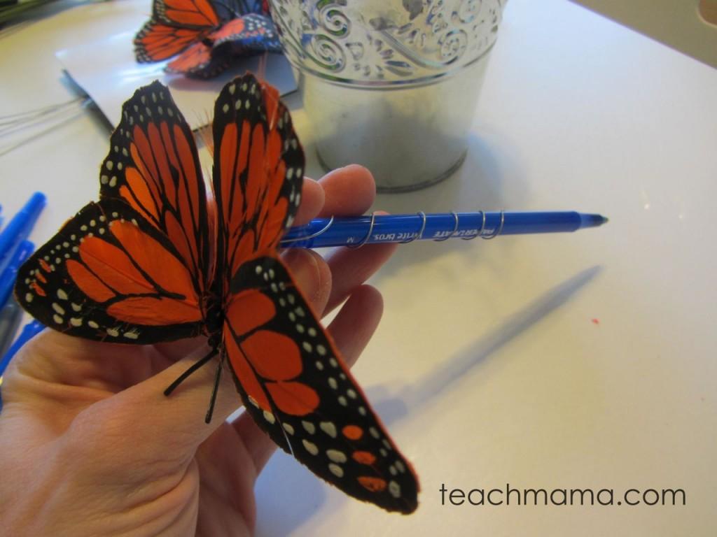 butterfly on a blue pen