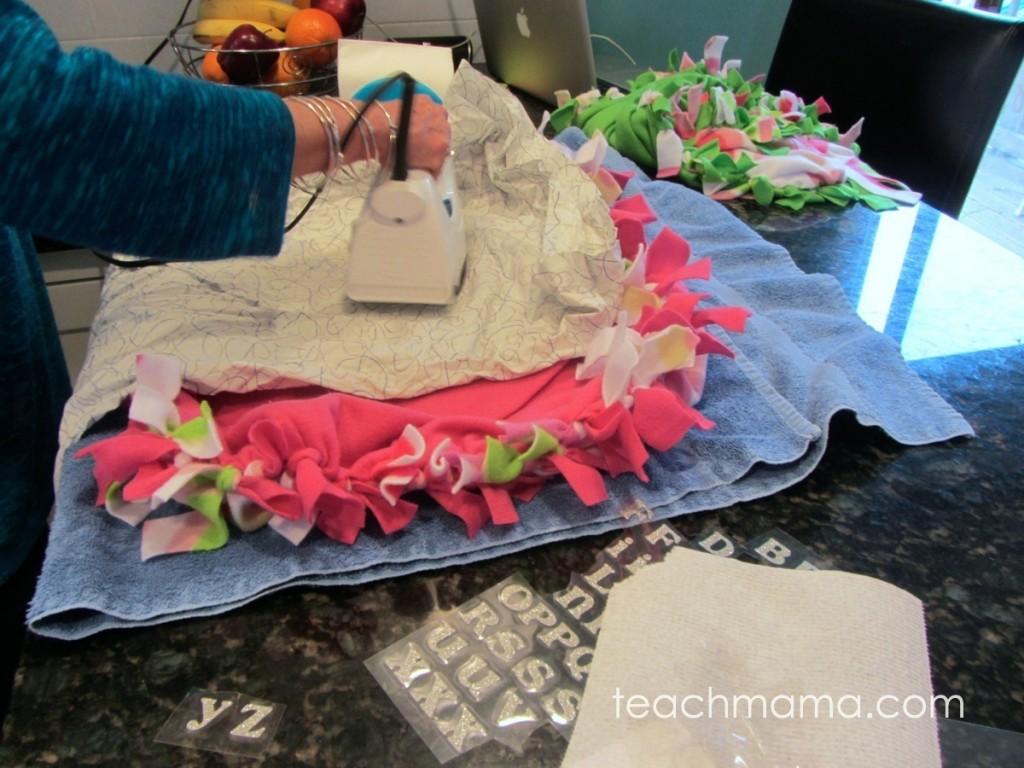 woman ironing fleece blanket