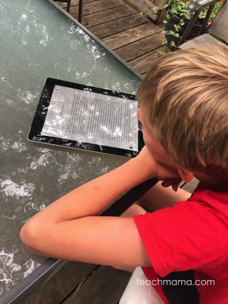 boy reading on a kindle device