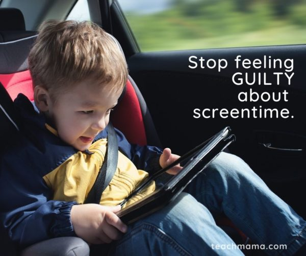 little boy on ipad in car