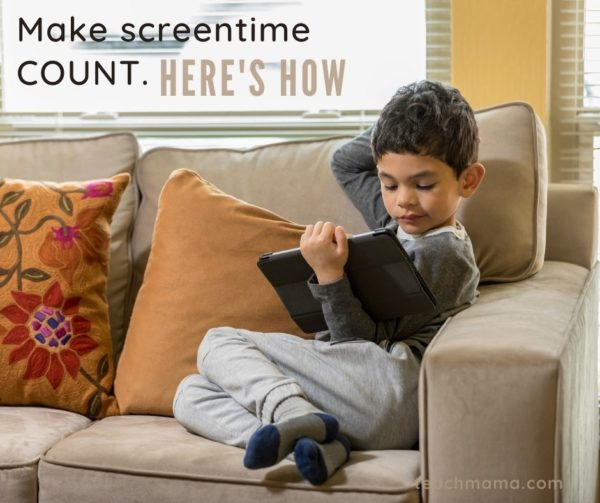 little boy on couch playing  HOMER on ipad