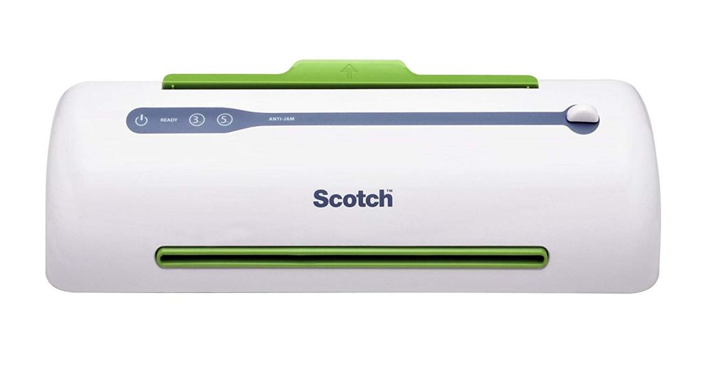 An image of a Scotch brand laminator.  It is white with green trim around the areas that the paper enters/exits.