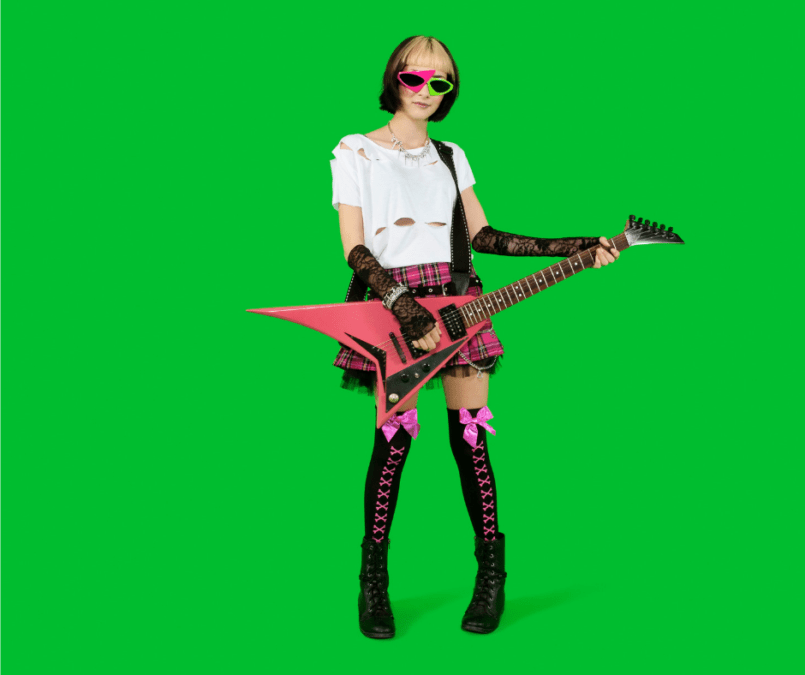 a punk rocker holding a guitar against a green background