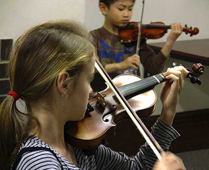 young violinists practising
