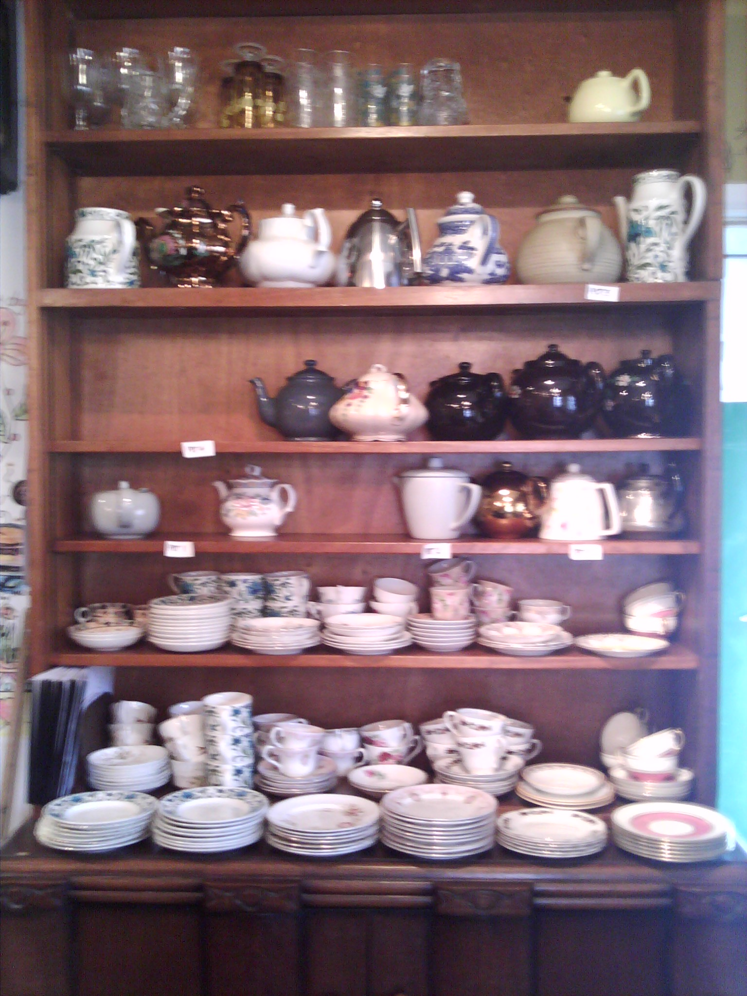 An array of teapots in The teashop by the canal