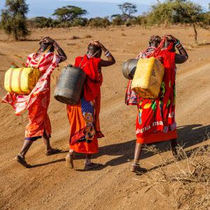 African women from Maasai tribe carrying water, Kenya, East Africa