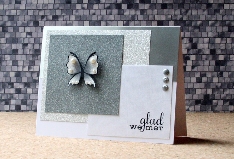 Layering glitter papers to create a geometric card background. It's a great way to use up paper scraps in your stash.