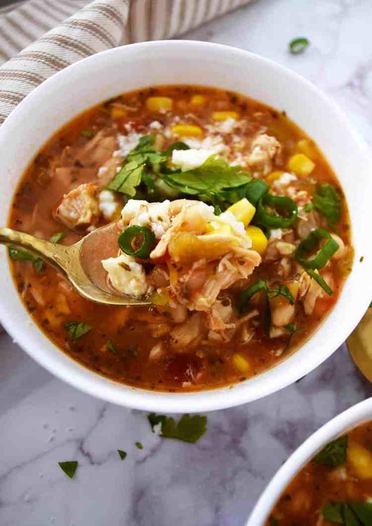 quick and easy dinner ideas, simple dinner ideas, easy white chicken chili that you can make in a slow cooker with queso fresco for a tasty white chicken chili recipe