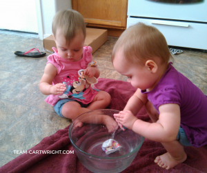 One-Year-Old Twins playing in water. Surviving life with one-year-old twins #twins #toddler