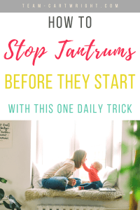 Mom with child with text overlay how to stop tantrums before they start with this one daily trick.