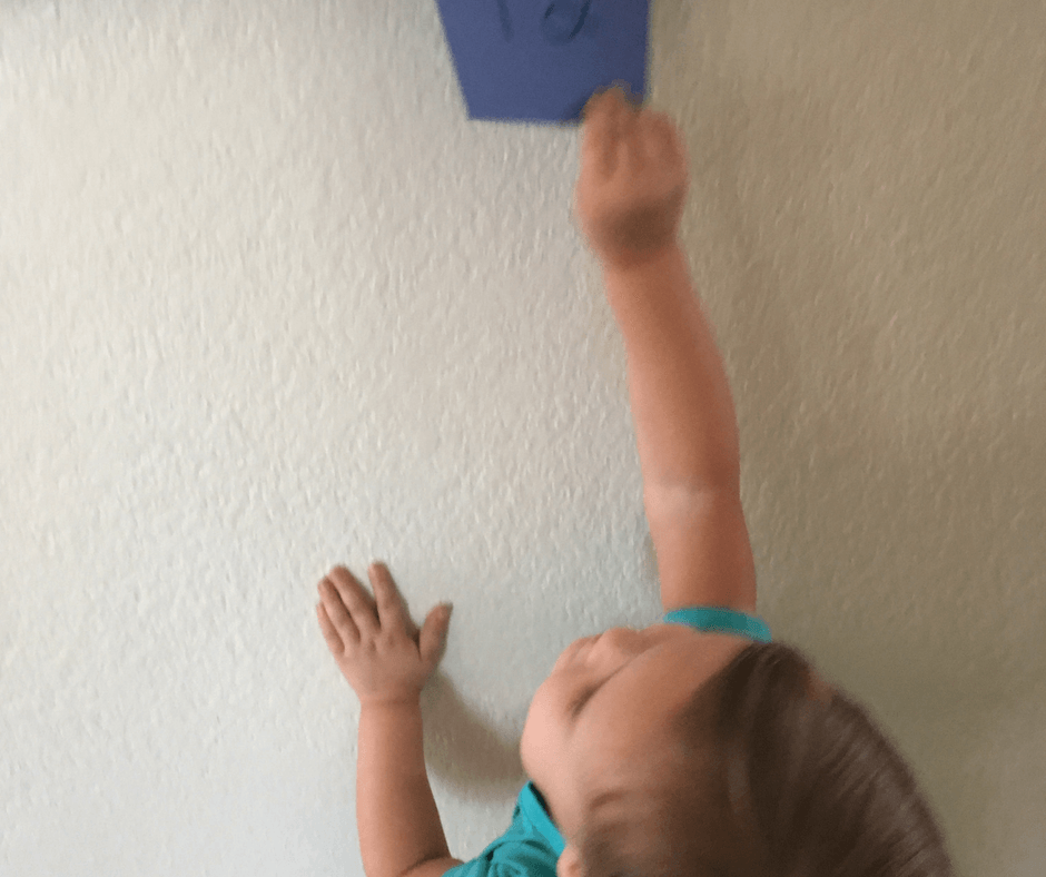 Simple number game! Tape numbers 1-12 on your wall. Then have your kids roll some dice, add up the numbers, and run to that number! Get the wiggles out and learn number sense! #learning #activity #number #sense #counting #adding #preschool #toddler #homeschool Team-Cartwright.com