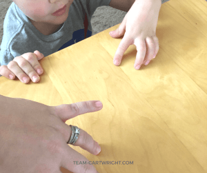 Learn why you can't life your ring finger when your other fingers are on the table. Get the explanation plus more fun and easy human body science experiments to wow your kids! Simple and fun tricks of perception. #STEM #science #learning #activity #human #body #experiment Team-Cartwright.com