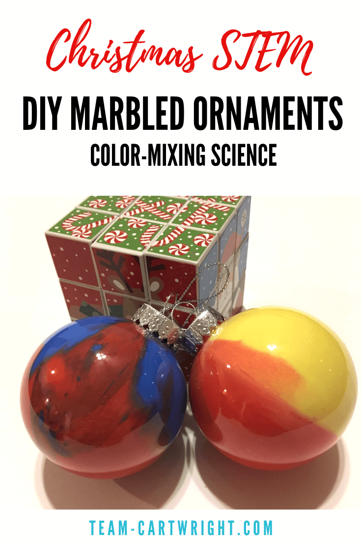 Homemade Marbled Ornaments for Kids! Make these easy and fast ornaments with your preschooler and toddler and have a little STEM fun! Learn about color mixing and make Christmas memories. #christmasSTEM #STEAM #christmascraft #christmasornament #homemadeornament #christmasscience #toddler #preschool #kids #learningactivity #christmaslearning Team-Cartwright.com