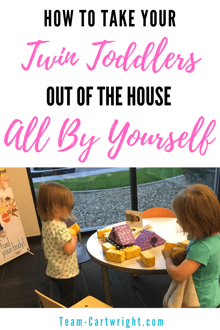 Picture of toddler twins playing with text overlay How To Take Twin Toddlers out of the house all by yourself