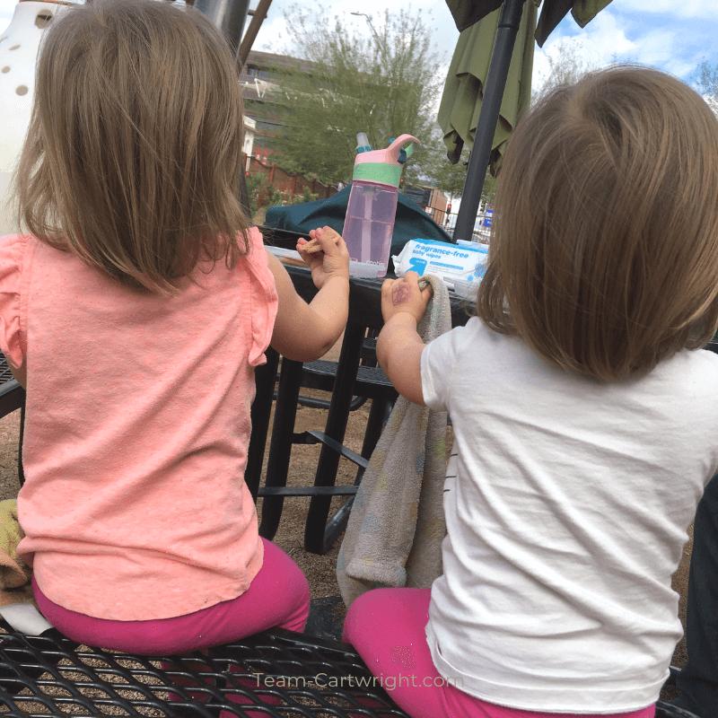 toddler twins facing away from camera