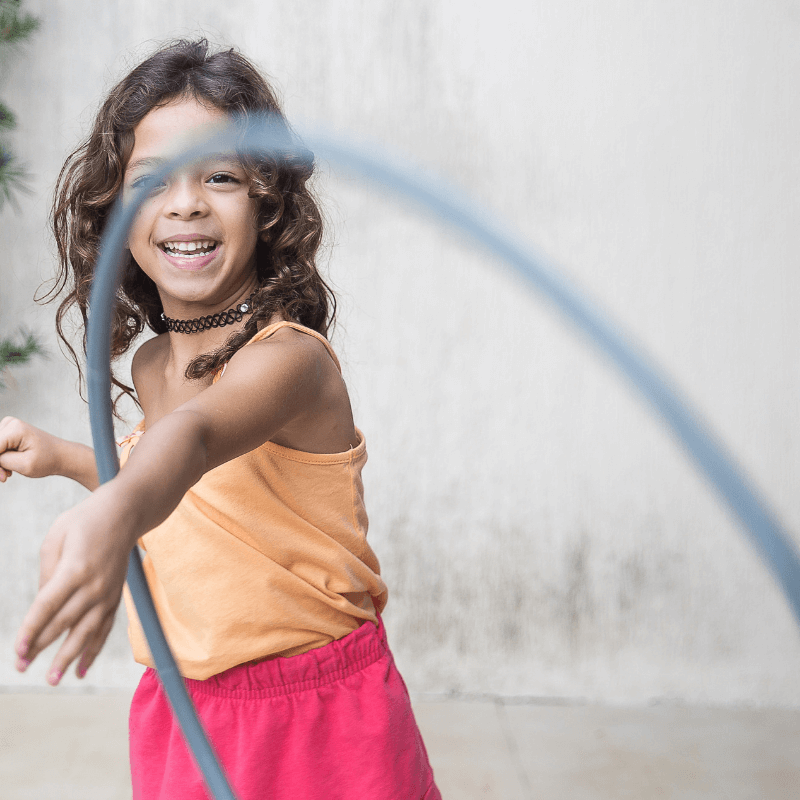 Preschool girl playing with hula hoop. Why Play Matters for Preschoolers