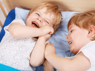 picture of twin boys giggling