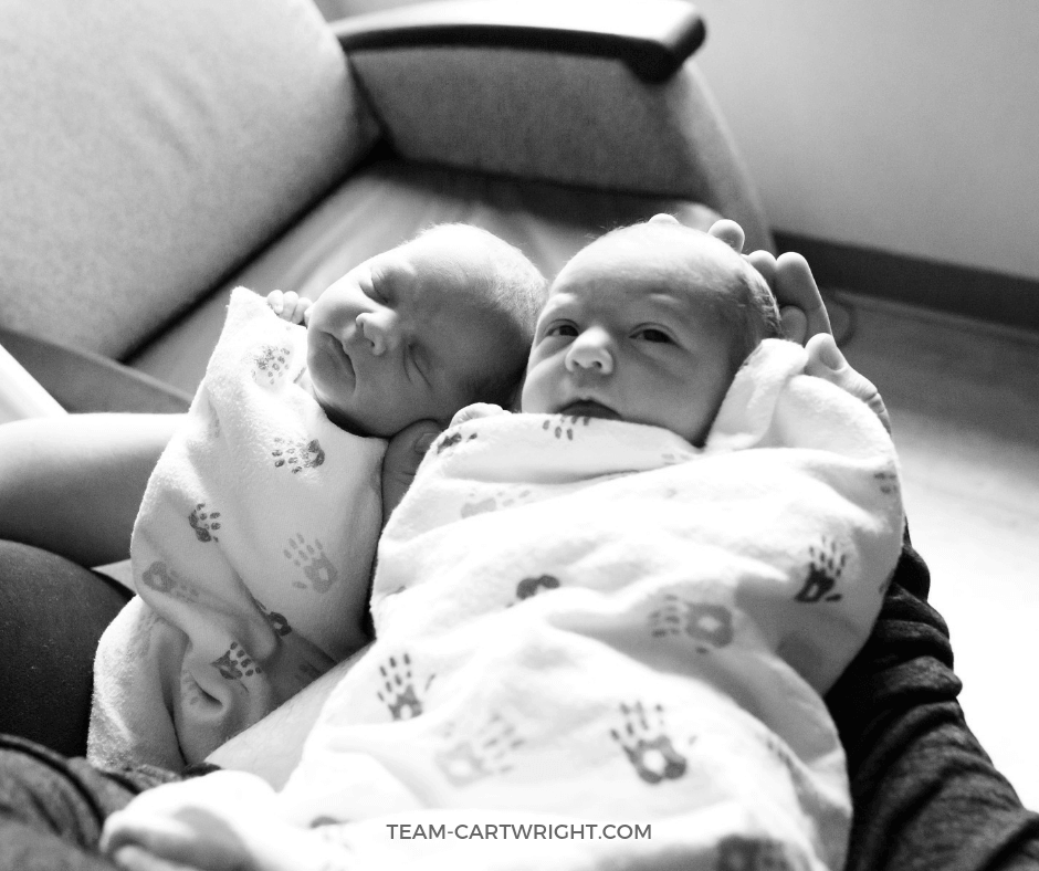 black and white picture of newborn twins
