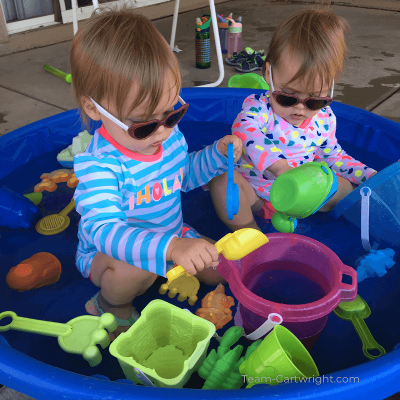 picture of two toddlers playing in a kiddie pool