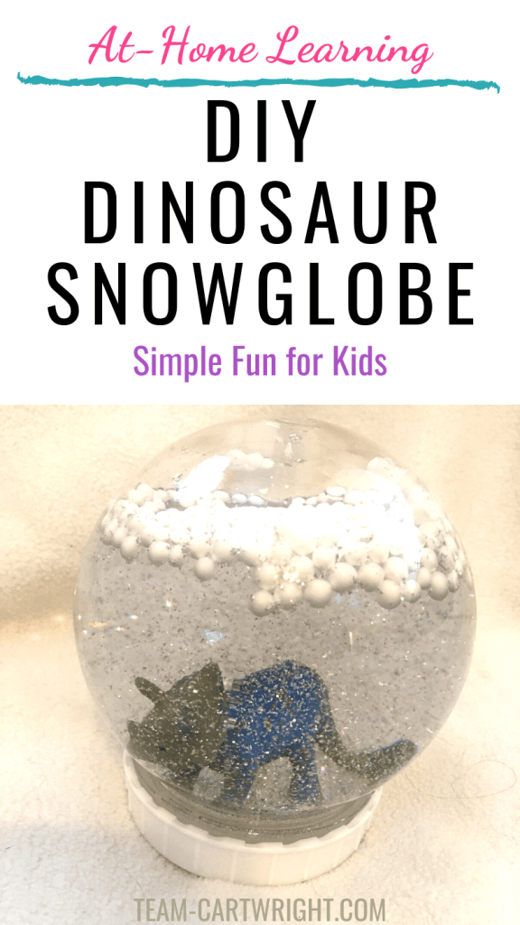 DIY dinosaur snowglobe with picture of a dino in a snowglobe