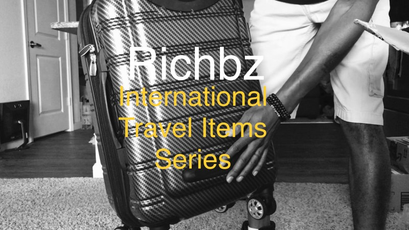 Richbz holding a Suitcase