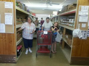 Volunteers filling an order for a client family.