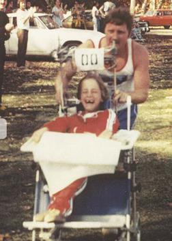 Antique photo of Rick Hoyt being pushed by his father Dick Hoyt in an old racing wheelchair. He has a big smile! Photo courtesy of Team Hoyt, TeamHoyt.com