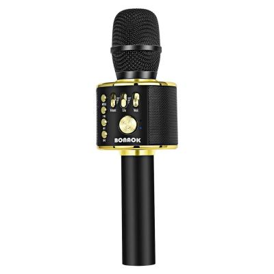 Picture of black and gold microphone.