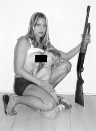 Really bad maternity pictures. Pregnancy and Guns! from Team Jimmy Joe!