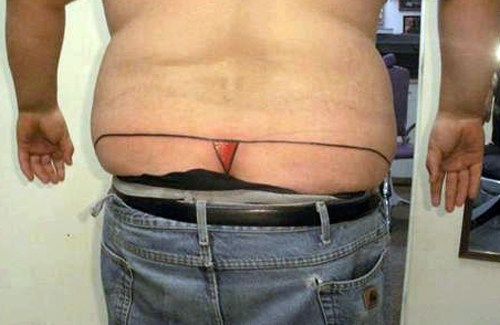 Whale Tail Thong Tattoo funny pictures bad tattoos terrible awful ugliest tattoos wtf tattoos, horrible awkward family worst tattoos photos crazy people weird people stupid humor redneck humor photobombs