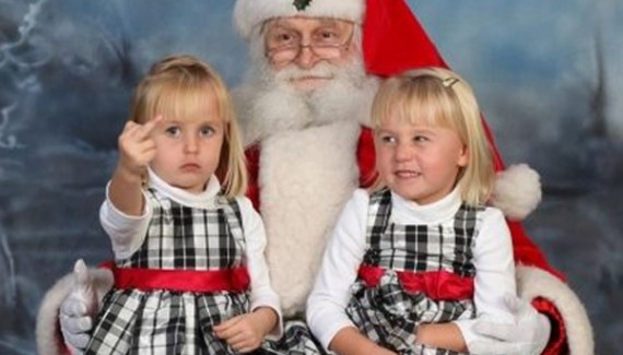 Girl Giving Finger on Sata's Lap Funny Christmas Photos Awkward Family Christmas Card ideas Pics Pictures Strange Family Holiday