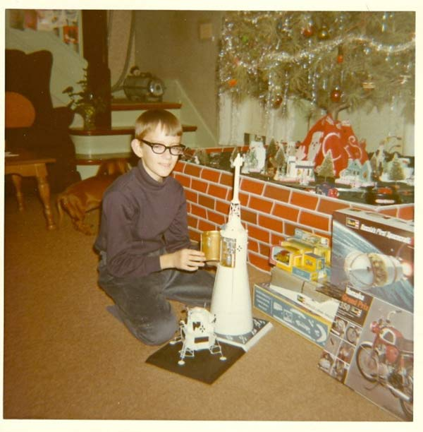 26 Funny Christmas Photos for the Whole Family ~ vintage snap 1970s kid presents Apollo rocket