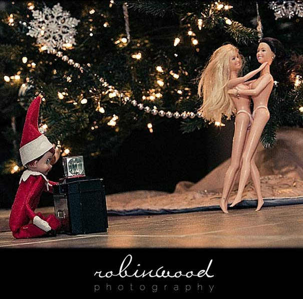 Inappropriate Elf photographing nude barbies