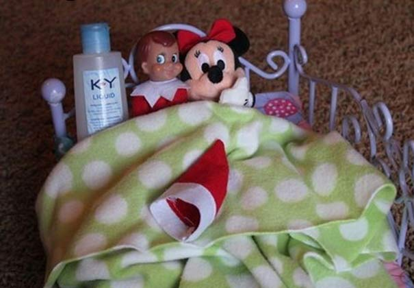 Inappropriate Elf in bed with Minnie Mouse