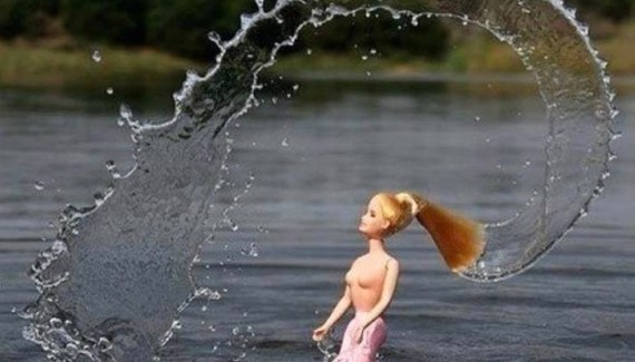 Barbie doll in lake flipping her hair