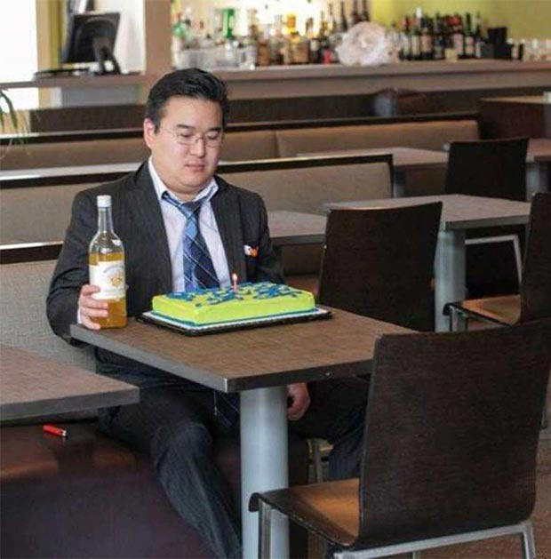 funny & Awkward ~ lonely man in restaurant celebrating birthday by himself with bottle of Boones Farm