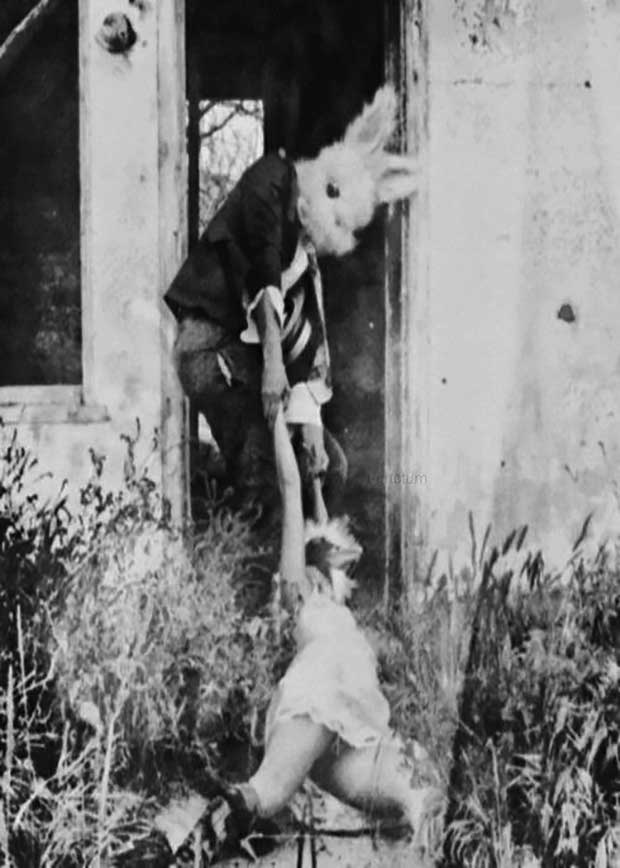 dragging woman's body ~ old creepy photos bunny mask
