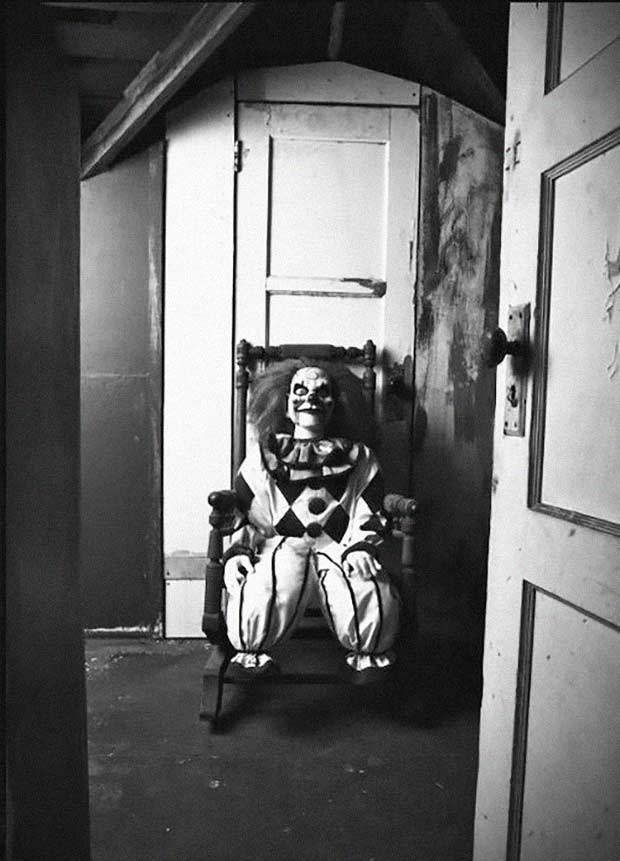 scary clown in rocking chair ~ old creepy photos