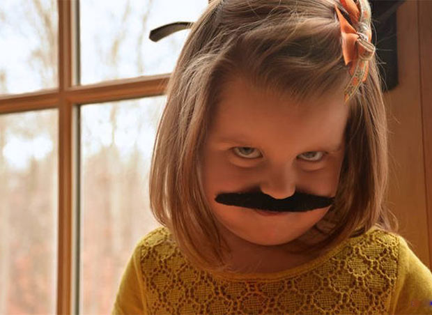 cute, sly girl with fake mustache ~.~ Awkwardly funny family photos