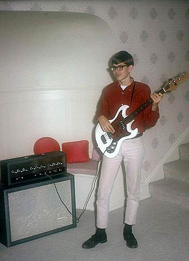 Calvin so desperately wanted to form the first Monkees cover band. Go for it, Cal. I'm a believer... `.`.`.~ Awkwardly funny family photos vintage snap 1960s boy bass guitar