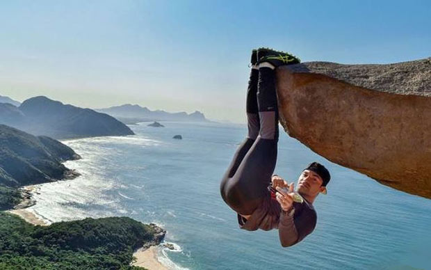 Nope. Crazy rock climber hanging from cliff by feet